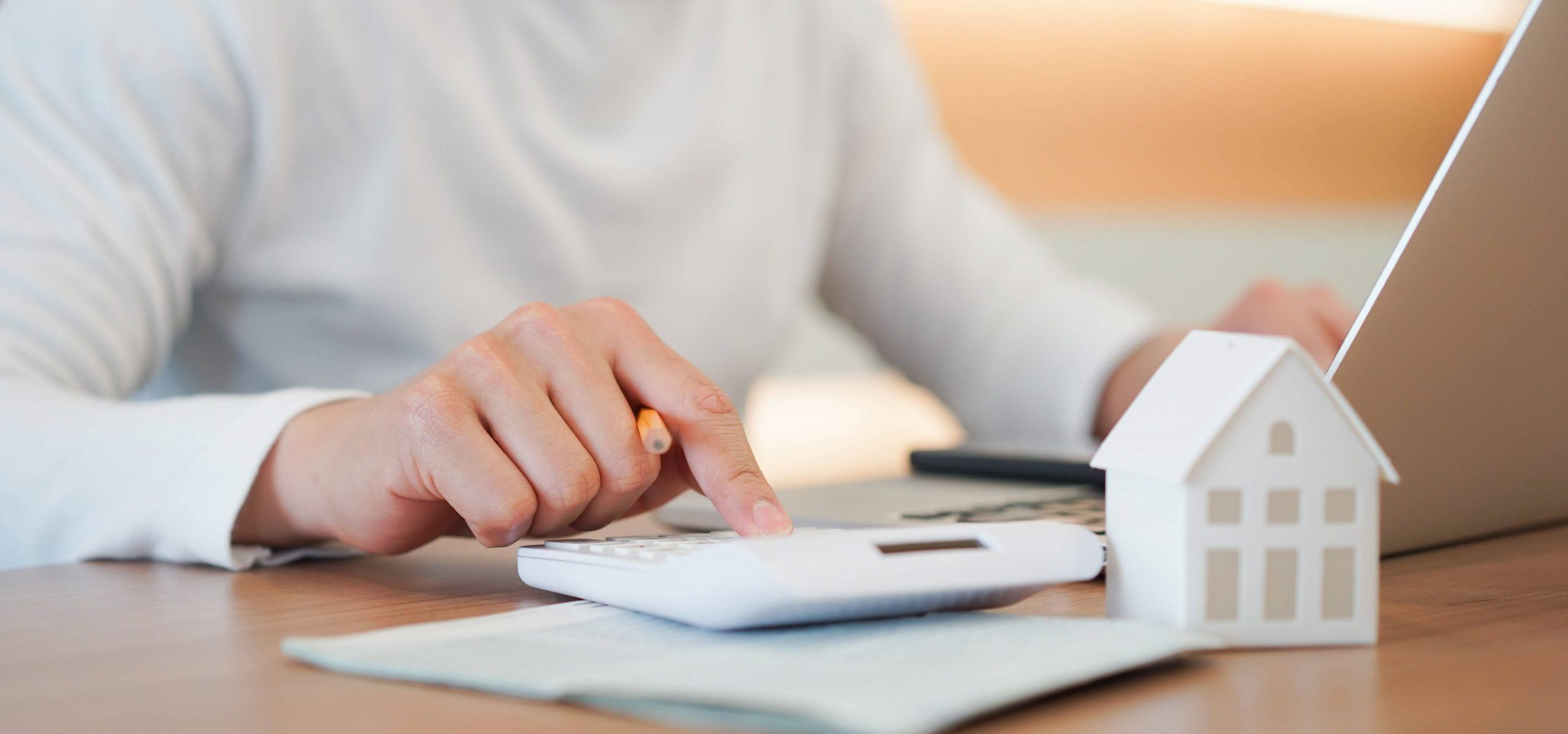 person doing calculations for a mortgage